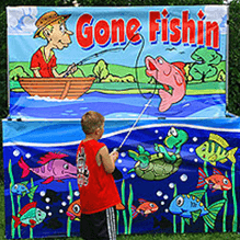 Boy playing Gone Fishing carnival game